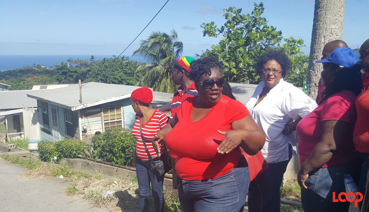 Carlitha Andrews(center) with Leader of the Opposition, Mia Mottley standing in the background.