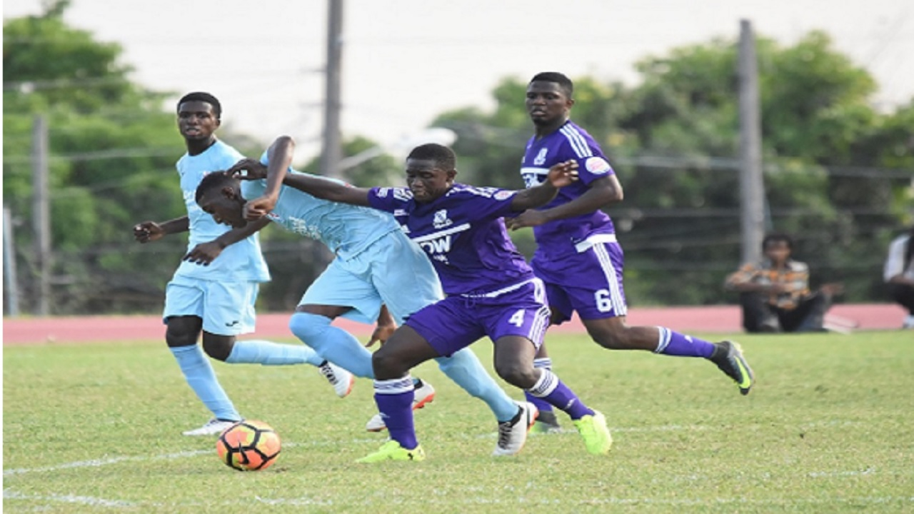 Picture shows action from the Walker Cup quarter-final match between defending champions Kingston College (KC) and St George's College last Wednesday at the Stadium East field. KC won 2-1 in extra-time.