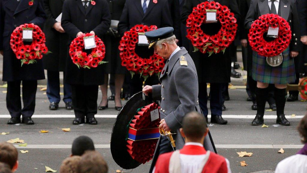 Britain's Prince Charles carries a wreath on behalf of Britain's Queen Elizabeth II during the service of remembrance at the Cenotaph in Whitehall, London, Sunday, Nov. 12, 2017. The annual service is to remember those who have lost their lives serving in the Armed Forces. (AP Photo/Tim Ireland)