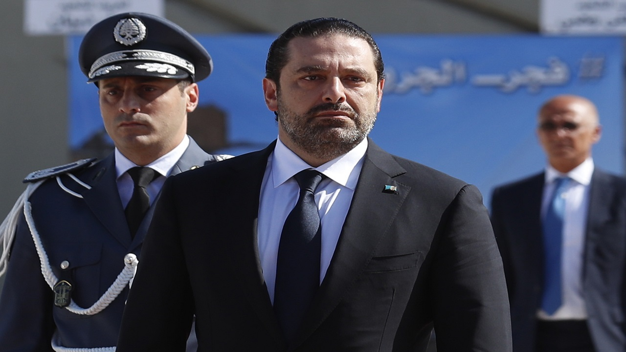 In this photo taken on Friday, Sept. 8, 2017, Lebanese Prime Minister Saad Hariri, left, arrives for a mass funeral of ten Lebanese soldiers at the Lebanese Defense Ministry, in Yarzeh near Beirut, Lebanon.