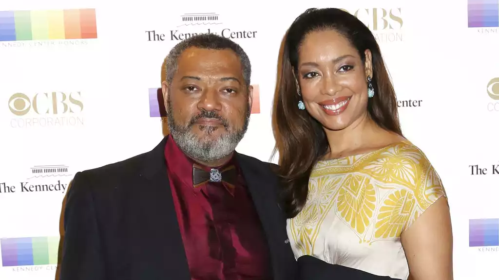 In this Dec. 6, 2015 file photo, Laurence Fishburne, left, and Gina Torres attend the 38th Annual Kennedy Center Honors at The Kennedy Center Hall of States in Washington. (Photo by Greg Allen/Invision/AP, File)