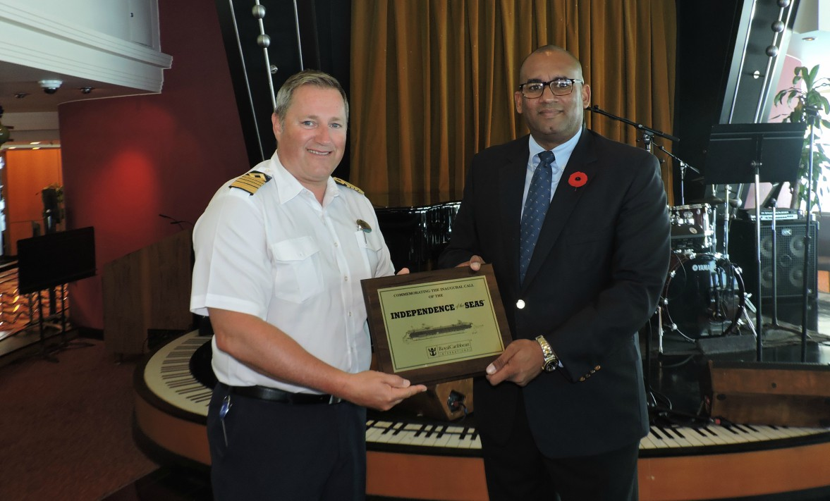 Captain Iv Vidos (left) and Minister of Tourism Richard Sealy during the exchange of plaques.