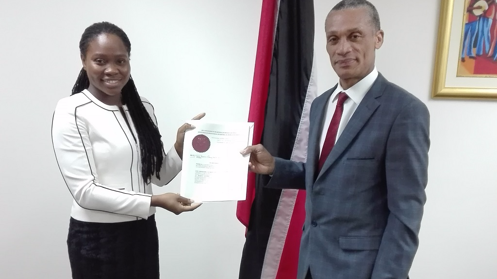 Senator the Honourable Dennis Moses, Minister of Foreign and CARICOM Affairs presents Instrument of Appointment to Her Excellency Makeda Antoine, Ambassador of the Republic of Trinidad and Tobago to the Permanent Mission of the United Nations in Geneva, Switzerland