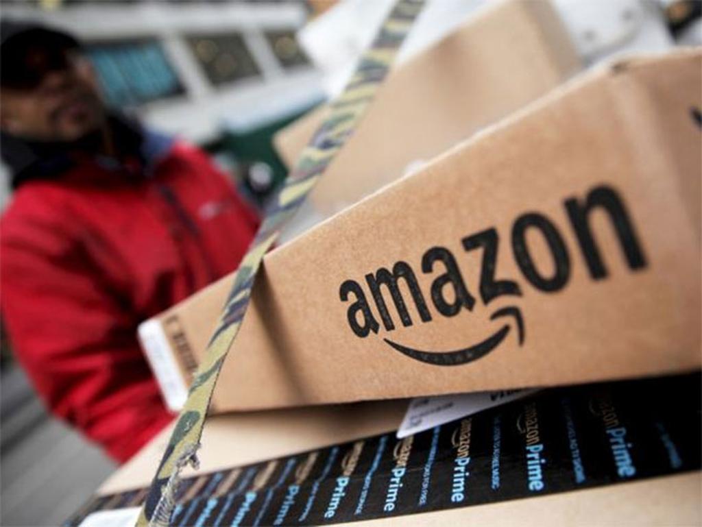 """Het aantal pakketjes dat arbeiders per uur moeten verwerken is """"onmogelijk"""" te halen."""