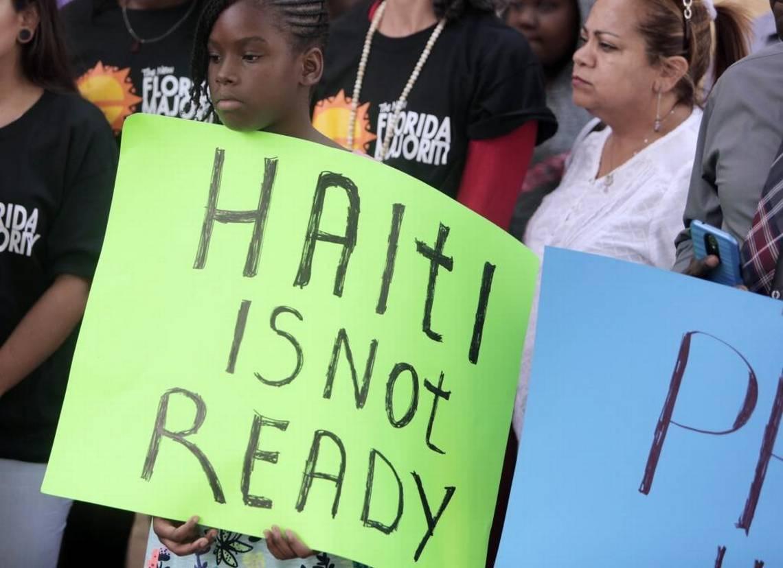 Des citoyens haïtiens militant pour le renouvellement du TPS aux USA.