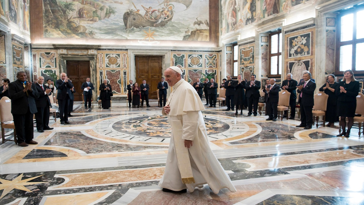 Pope Francis walks in the Clementine Hall after meeting with a delegation of Pacific leaders to discuss climate issues, at the Vatican, Saturday, Nov. 11, 2017