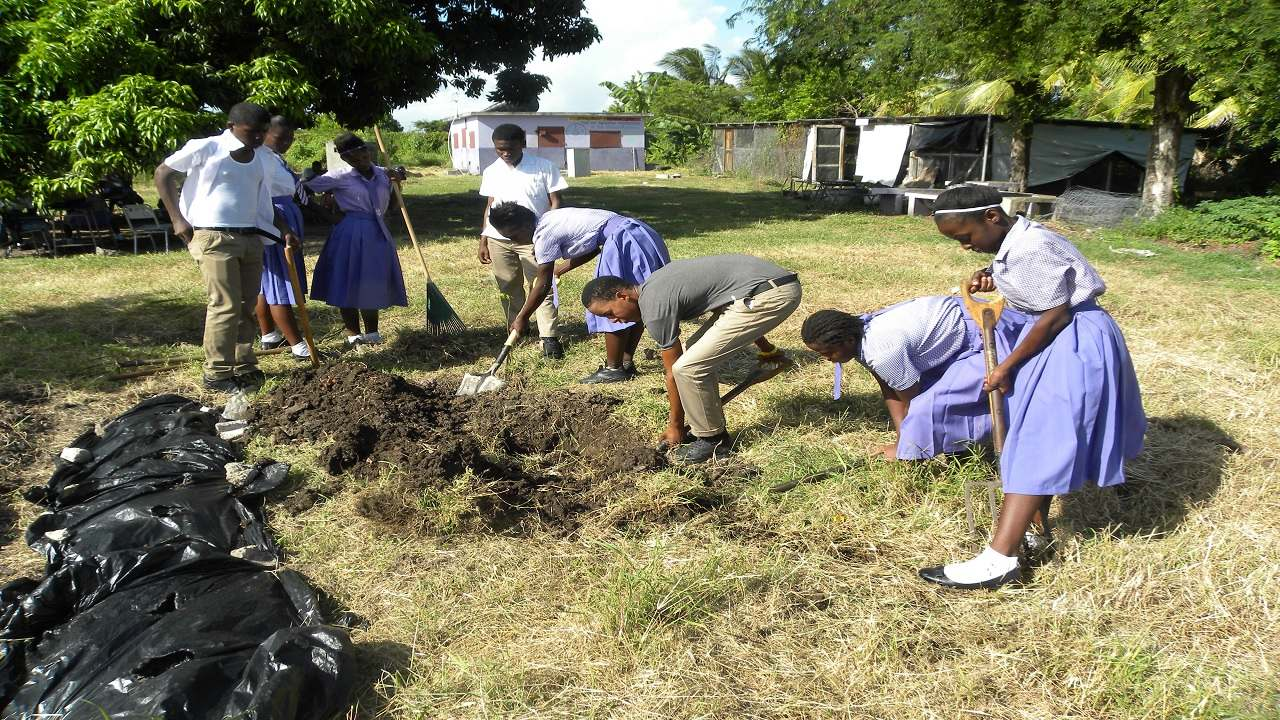 Students double digging at Bustamante High School.