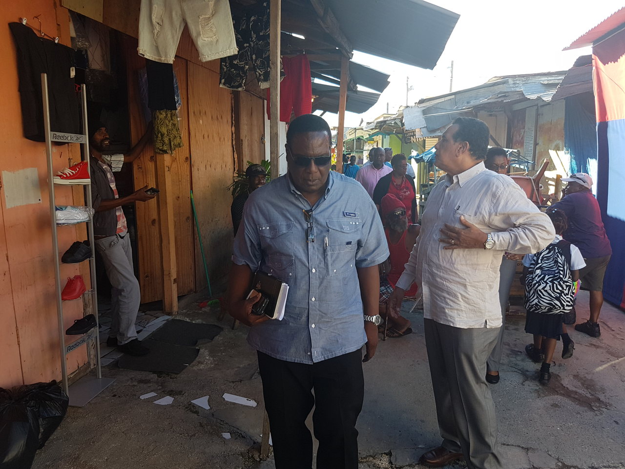 Mayor of Montego Bay, Homer Davis (right), and his Deputy, Leroy Williams, during a tour of the Old Shoes Market in Montego Bay on Monday.