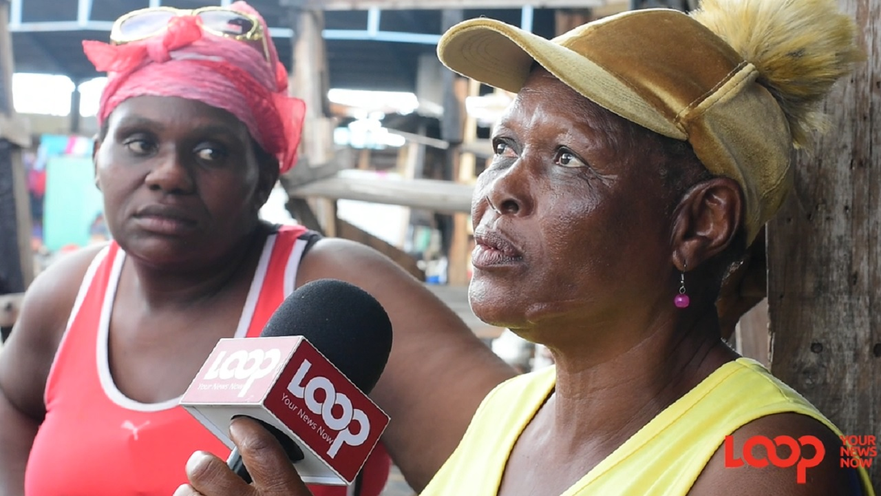 Vendors of the Ray Ray Ground market in downtown Kingston speak with Loop News after their stalls were destroyed by fire last week.