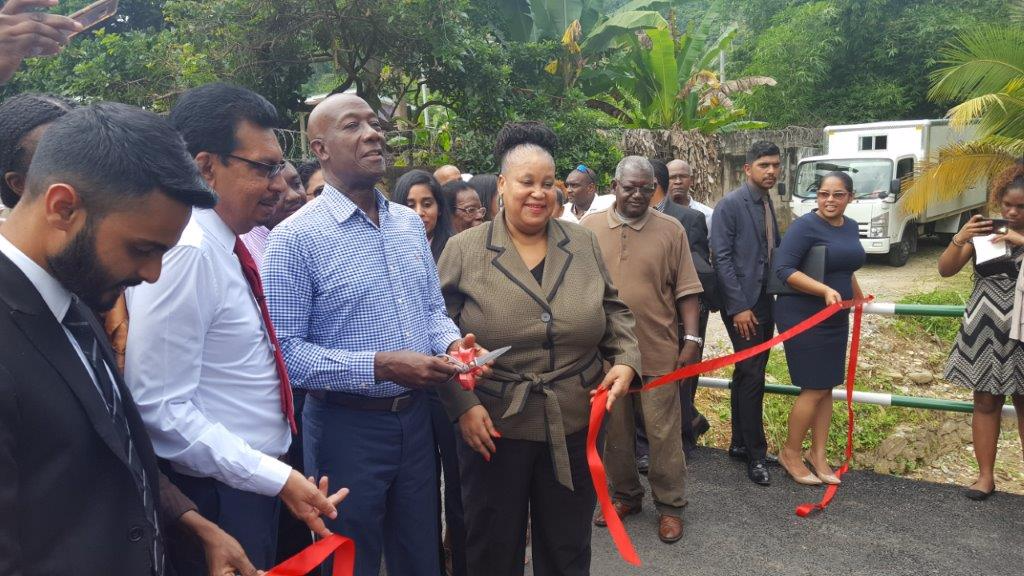Prime Minister Dr Keith Rowley cuts the ribbon to formally open a bridge connecting Spaniol and Covigne Roads in Diego Martin.