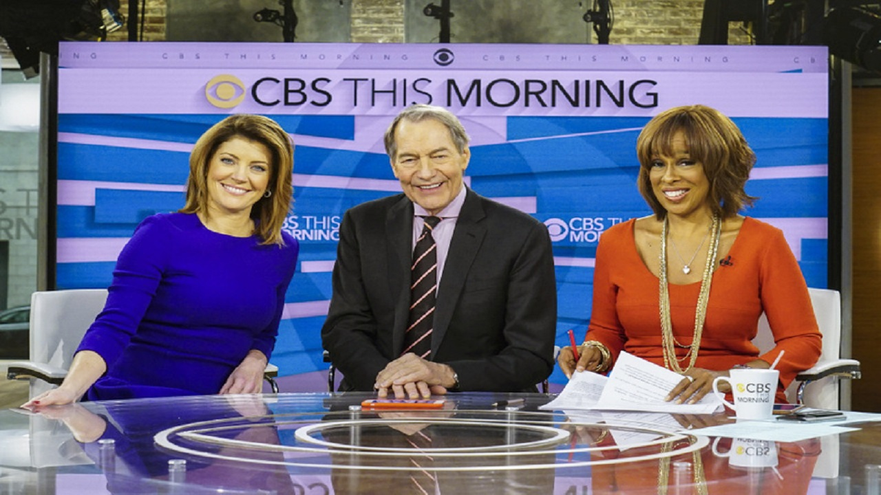 "This image released by CBS shows, from left, Norah O'Donnell, Charlie Rose and Gayle King on the set of ""CBS This Morning."" Rose's co-hosts on ""CBS This Morning"" sharply condemned their suspended colleague Tuesday, Nov. 21, 2017, after the airing of sexual misconduct allegations that included groping female staffers and walking around naked in front of them, saying that it's a time of reckoning in society."