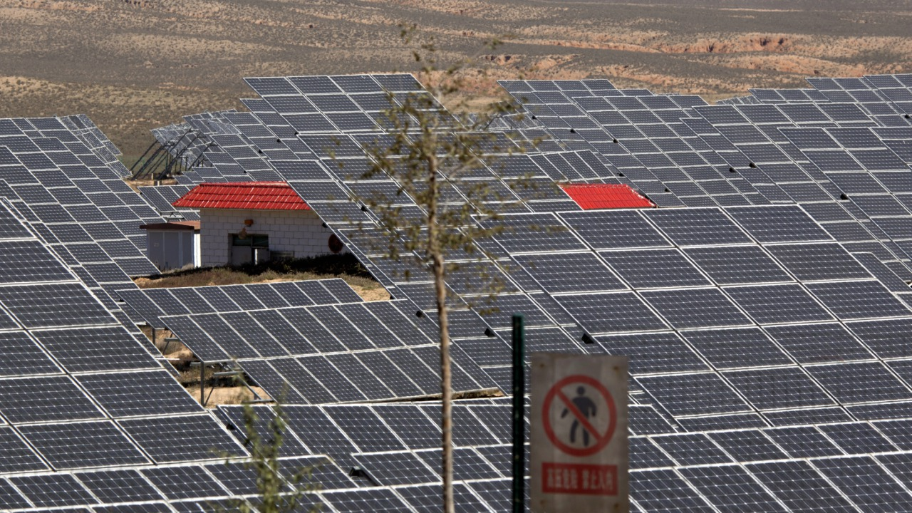 In this file photo dated Saturday, Oct. 10, 2015, an array of solar panels absorb the power of the sun, in northwestern China's Ningxia Hui autonomous region.