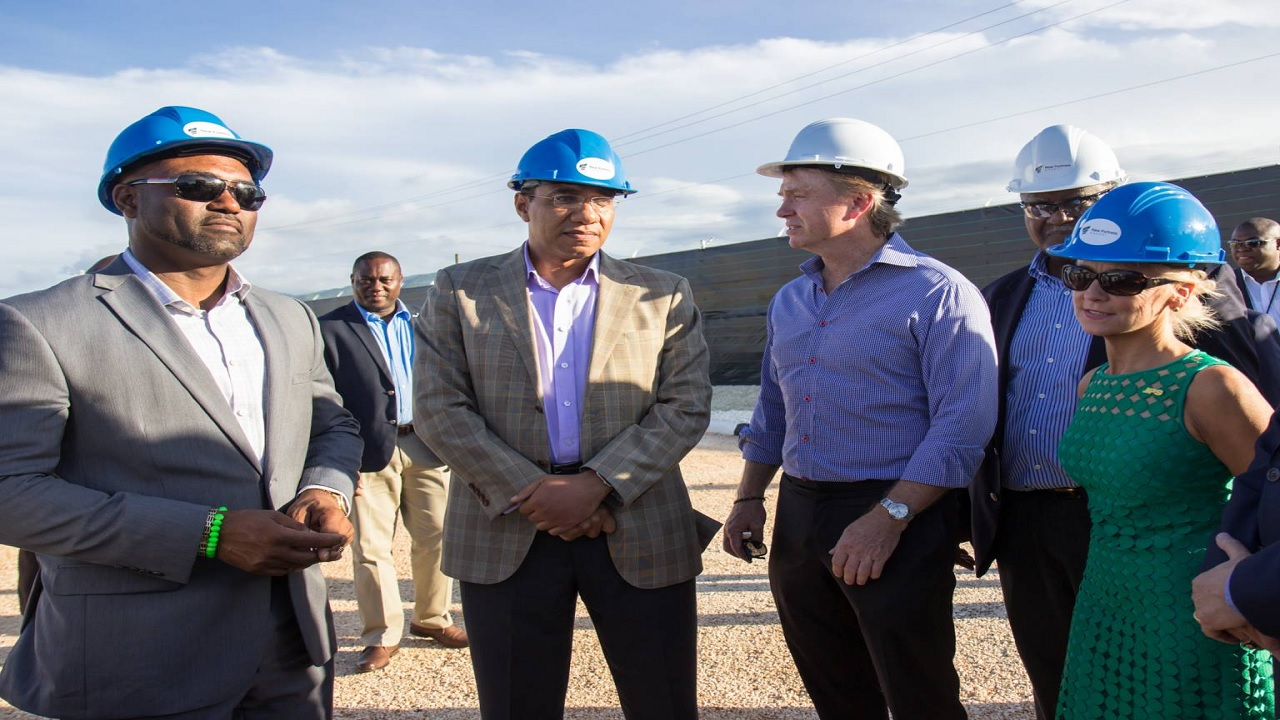 Prime Minister Andrew Holness (second left) and Minister of Science, Energy and Technology, Dr Andrew Wheatley (left), listen to CEO of New Fortress Energy, Wes Edens (third left) , during a tour of the liquefied natural gas (LNG) Terminal at the Montego Bay port last year. Also pictured are (from fourth left) Chairman of the Electricity Sector Enterprise Team, Dr Vin Lawrence, and then CEO of JPS, Kelly Tomblin. (PHOTO: JIS)