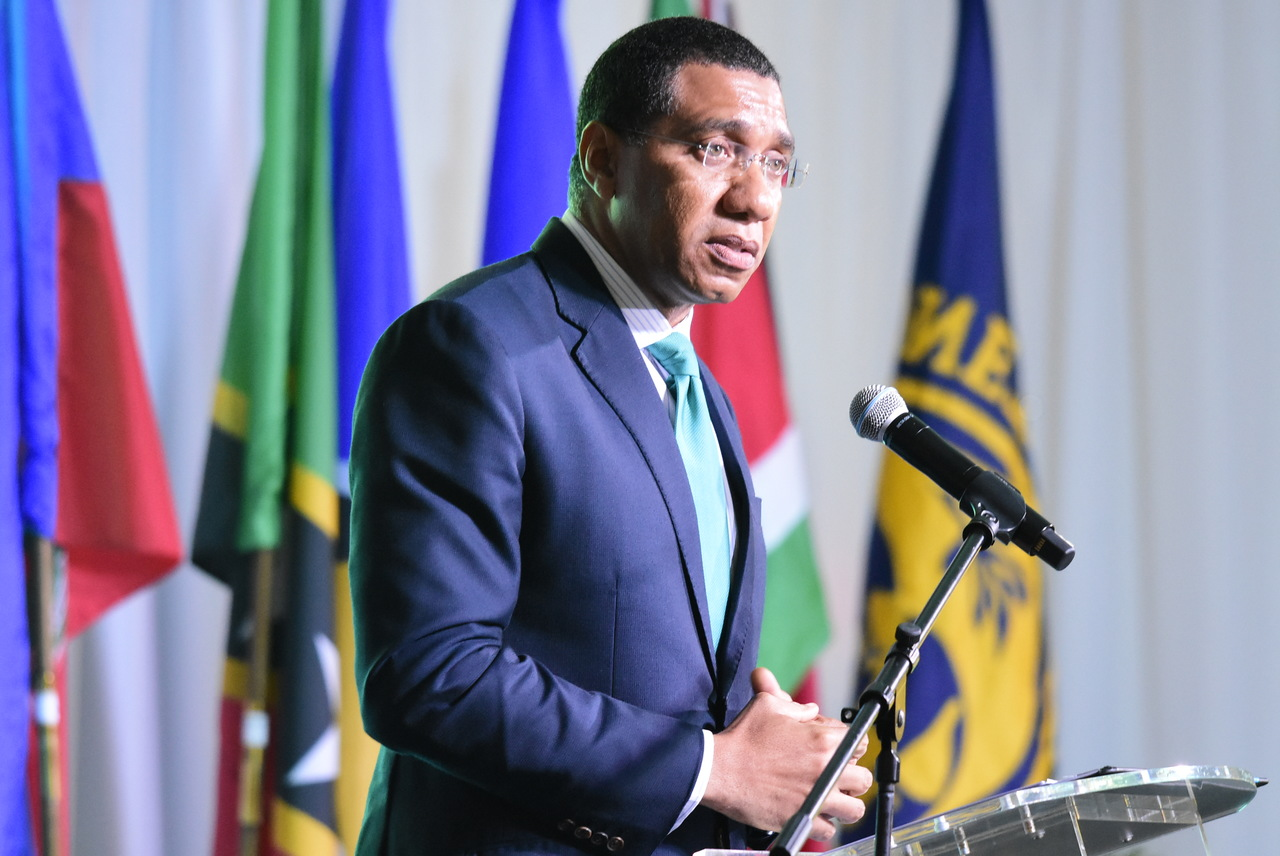 Prime Minister Andrew Holness addressing Thursday's regional conference in Kingston.