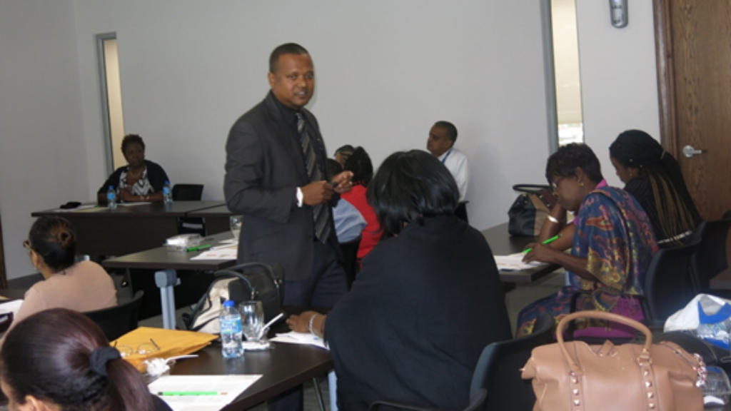 NIB's Public Relations Officer, Radesh Bassant, as he conducted the information workshop targeting Social Welfare Officers of the Ministry of Social Development and Family Services.