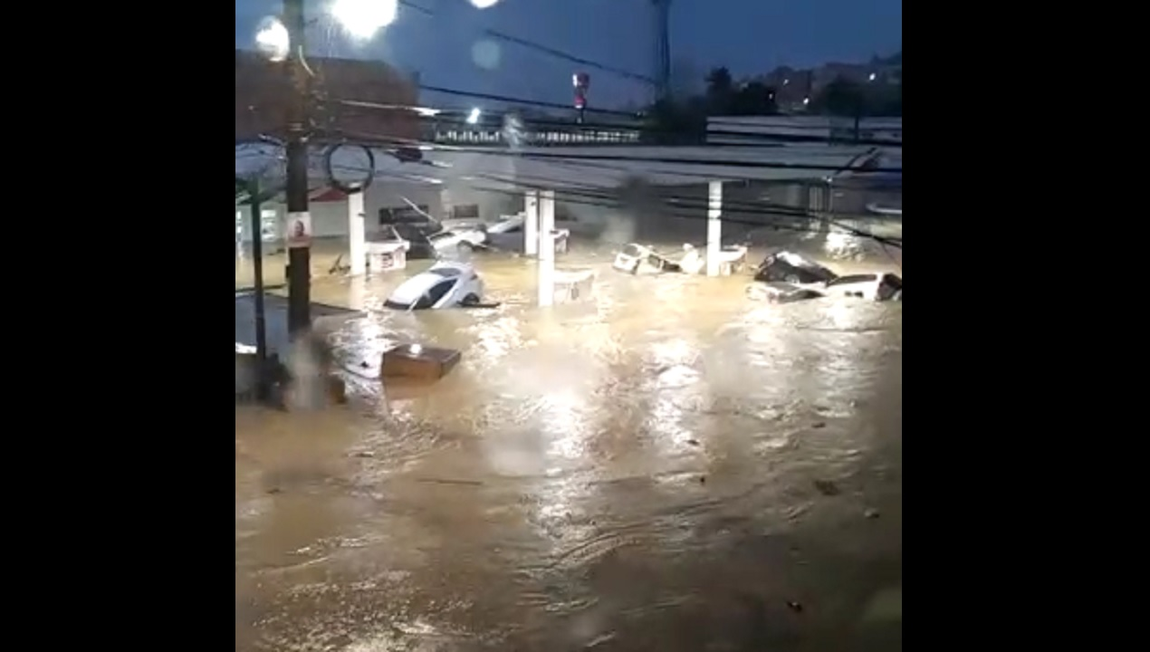 Screenshot of a video showing cars partially submerged in water in Montego Bay, St James.