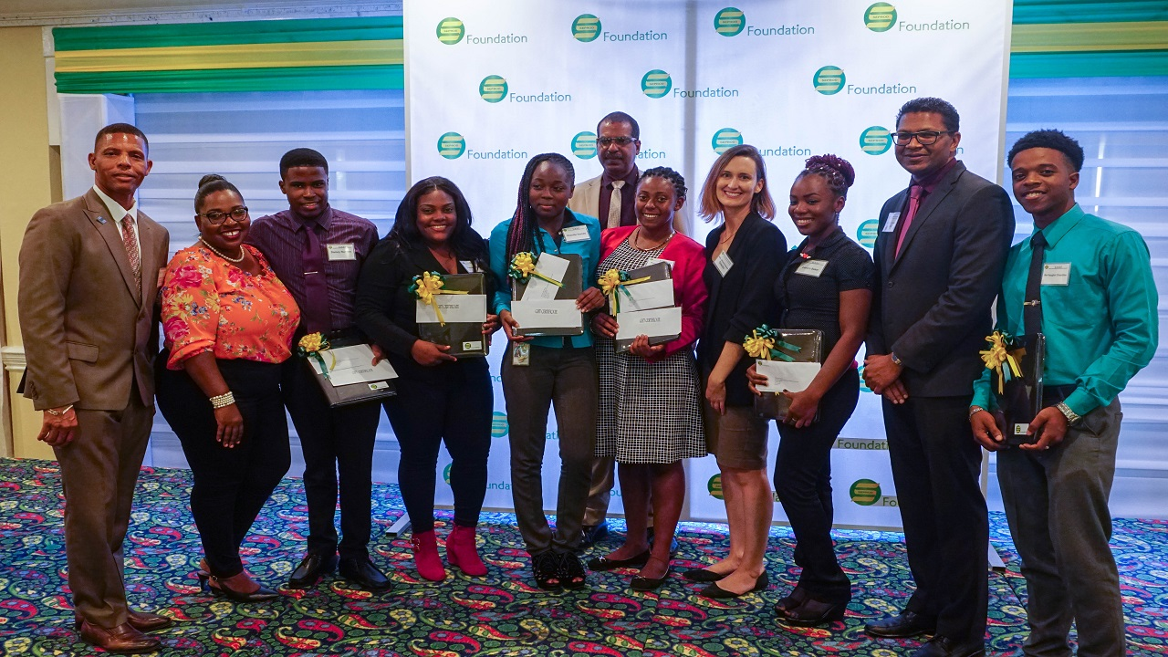 From left:  Dr Patrick Sterling, Seprod Executive; Monique Oates, Public Relations and Communications Co-ordinator, CASE; CASE scholarship awardees: Damoy  Rumble, Naema Bandoo and Chenille Hume; Dr Gavin Bellamy (back row), Seprod Executive; CASE scholarship Awardee Kerrisa Jones;  Melanie Subratie, Director, Seprod Foundation; CASE scholarship Awardee Lavern Baker; Richard Pandohie,  CEO, Seprod and Ke'Vaughn Chantilou, CASE scholarship awardee.