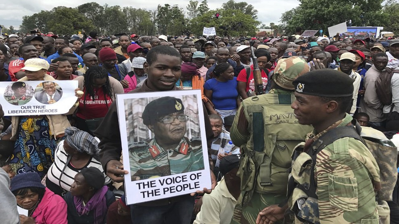 People gather to demonstrate for the ouster of 93-year-old President Robert Mugabe who is virtually powerless and deserted by most of his allies, in Harare, Zimbabwe, Saturday, Nov. 18, 2017.