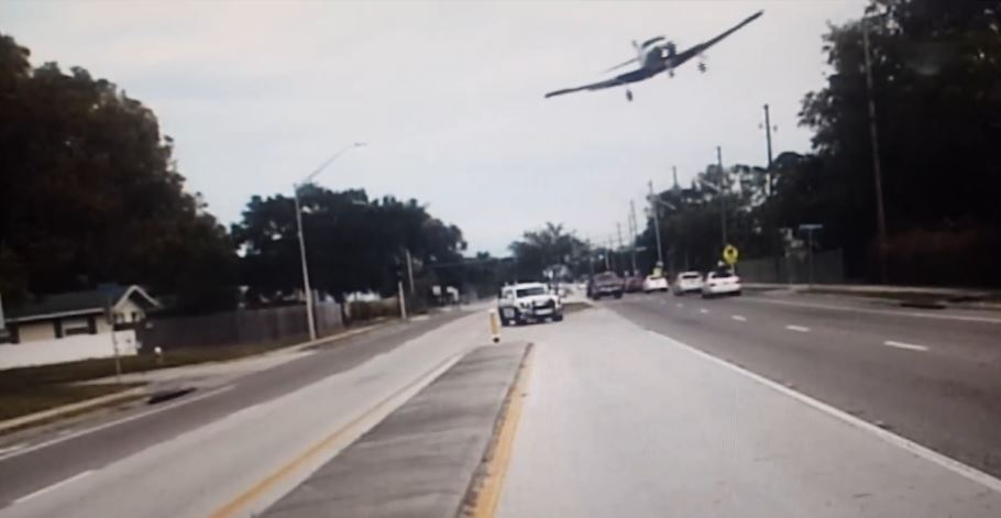 Plane crash lands on busy Florida road