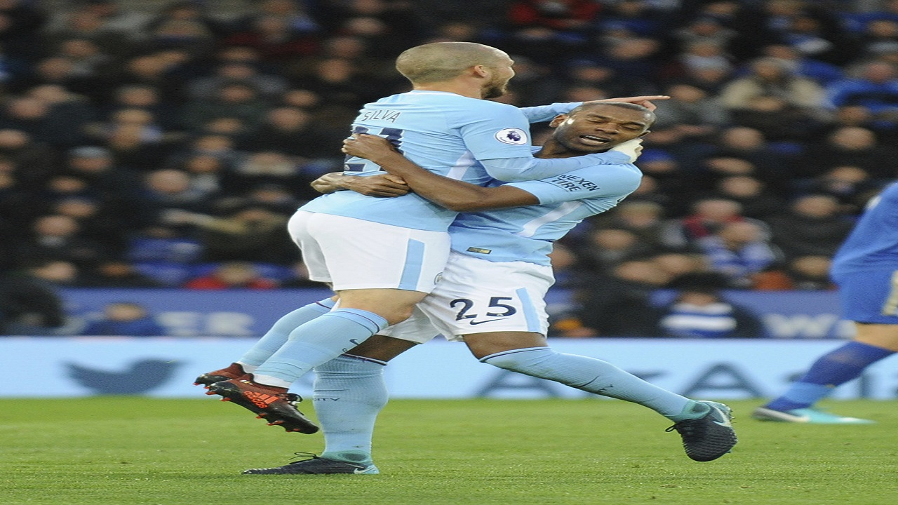Manchester City's David Silva, left, celebrates with teannate Fernandinho after Gabriel Jesus scored during the English Premier League football match against Leicester City at the King Power Stadium in Leicester, England, Saturday, Nov. 18, 2017.