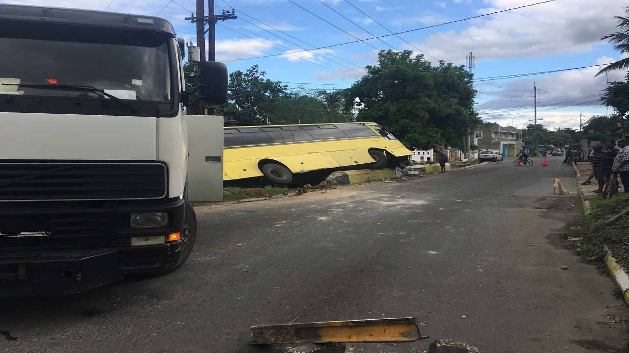 A JUTC bus is pictured in the background after it crashed on Monday morning.