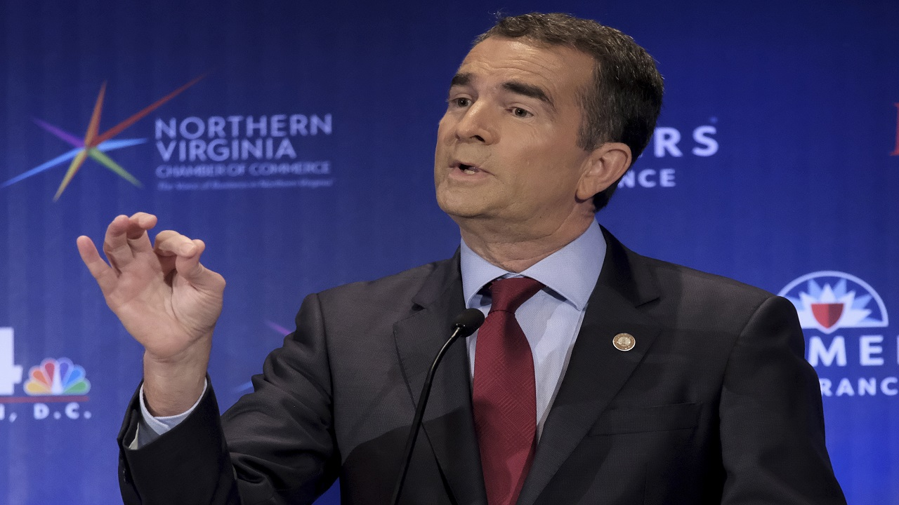 In this Sept. 19, 2017 file photo, Democrat, gubernatorial candidate Lt. Gov. Ralph Northam describes his view on confederate monuments in McLean, Va. Voters in Virginia and New Jersey are picking new governors in contests that could be an early referendum on President Donald Trump.