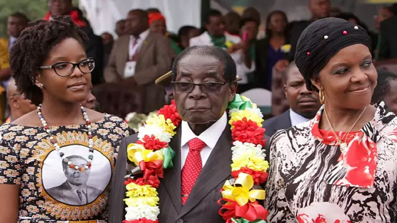 Zimbabwe's President Robert Mugabe celebrates his 91st birthday with his daughter Bona, left, and wife Grace (PHOTO: AP)