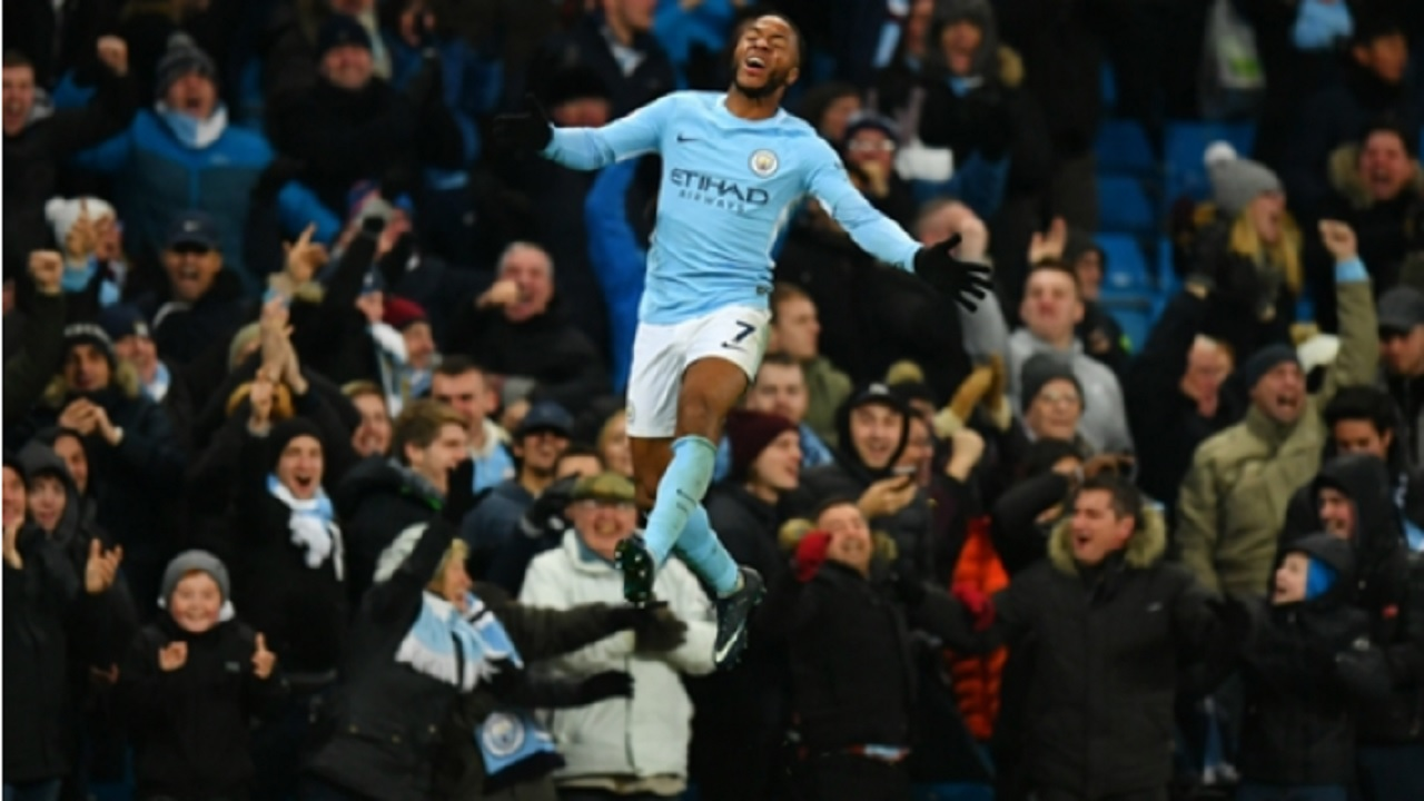 Raheem Sterling celebrates Manchester City's winner against Southampton.