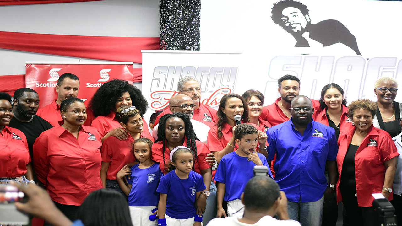 Members of the Shaggy Make A Difference Foundation, including Orville 'Shaggy' Burrell (back row, third from right) with Bustamante Hospital for Children staff and patients at the launch of the Shaggy & Friends benefit concert on Wednesday. (PHOTOS: Marlon Reid)