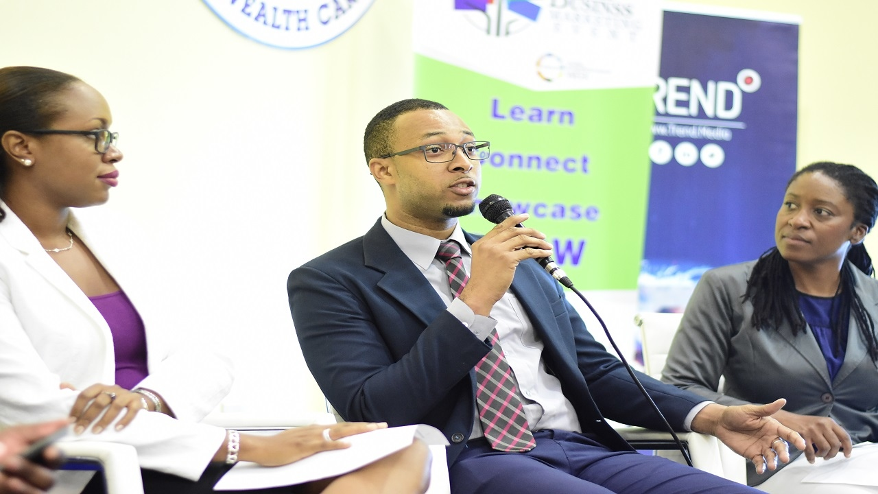 Andre Wedderburn, Head of Media Operations at Trend Media, makes a point during a panel discussion at the UCC Small Business Marketing Event. (PHOTOS: Marlon Reid)