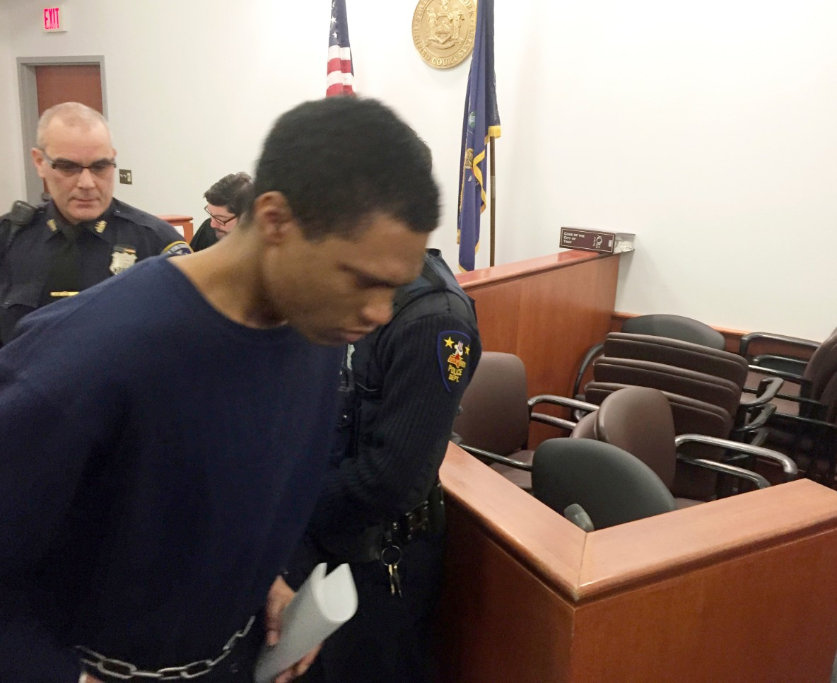 Justin Mann enters the court room for his arraignment on murder charges. (Steve Hughes/The Albany Times Union via AP)