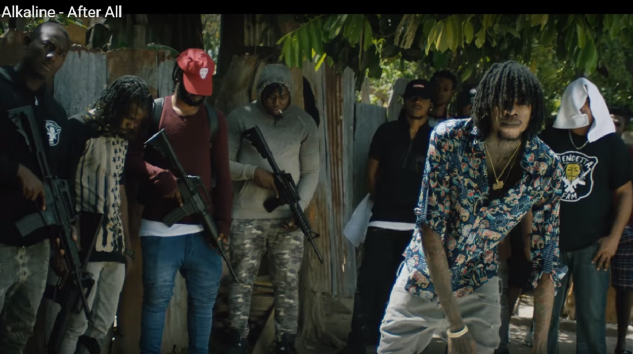 Dancehall artiste Alkaline (foreground) in a scene from the 'After All' video, which came in for heavy scrutiny for allegedly promoting violence, including murder.