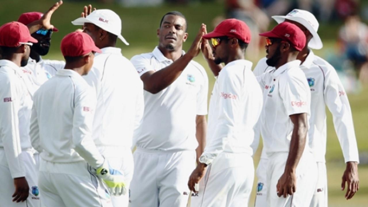 West Indies bowler Shannon Gabriel celebrates with teammates.