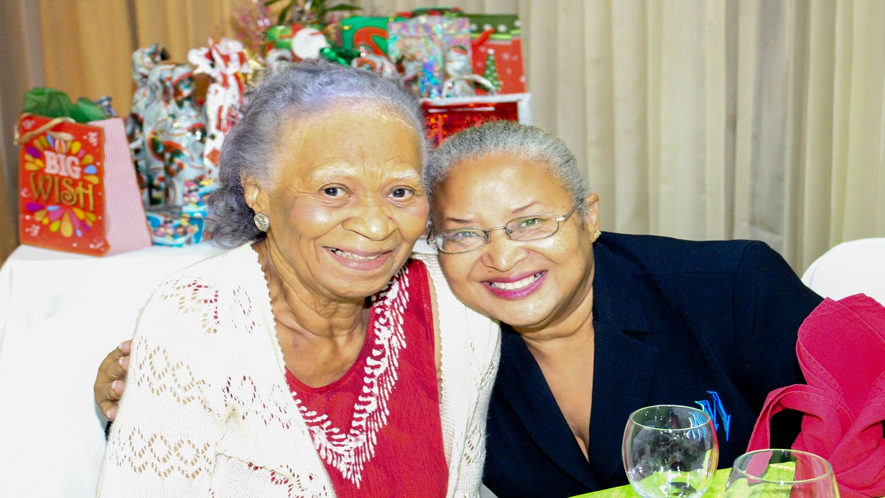 Merel Hanson (left) of the Retired Nurses Association  shares a smile with CEO of the Mayberry Foundation, Kayree Berry-Teap at the annual Retired Nurses Luncheon held at the Alhambra Inn.