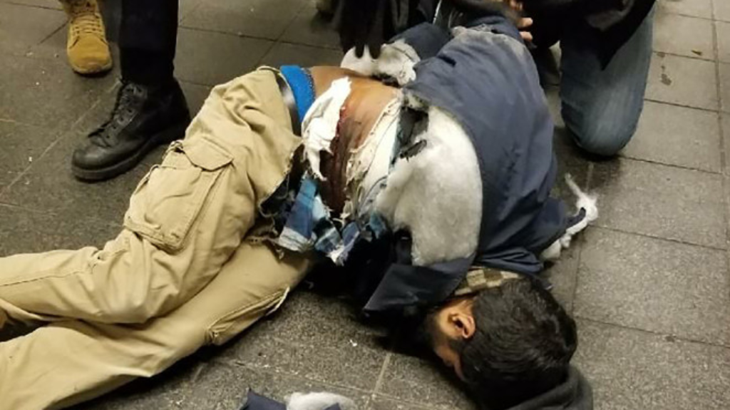 The suspect in police custody following an explosion at Port Authority Bus Terminal (Photo: New York Post)