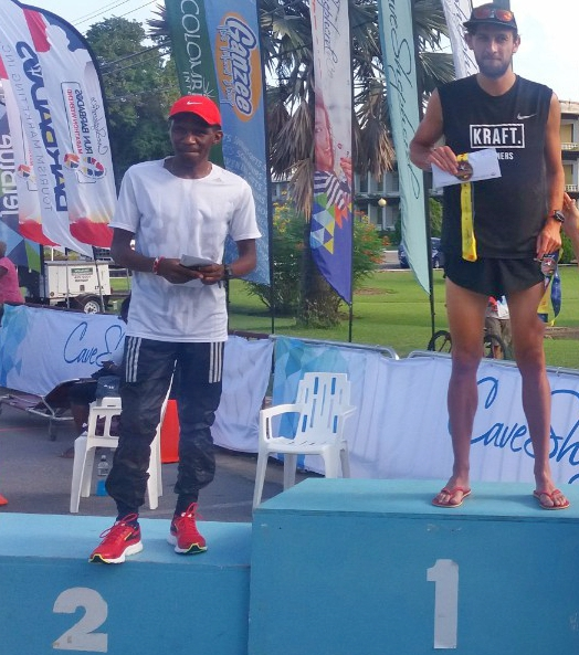 (L-R) Jean Habarurema of France finished second in the 2017 Run Barbados Marathon, while Paul Schmidt of Germany crossed the line first.