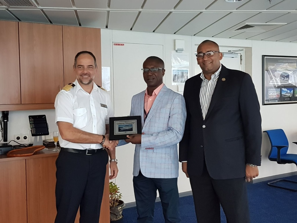 Captain George Latrou accepts plaque from Chief Executive Officer of the Barbados Port Inc. (BPI) David Jean-Marie and Minister of Tourism Richard Sealy.