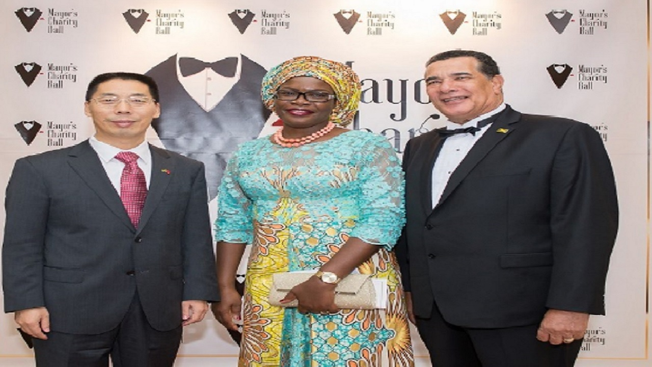 From left: Niu Qingboa, Chinese Ambassador to Jamaica; Janet Omoleegho Olifa, Nigerian High Commissioner to Jamaica, and  Montego Bay Mayor, Homer Davis, at the mayor's charity ball on Saturday at the Montego Bay Convention Centre.
