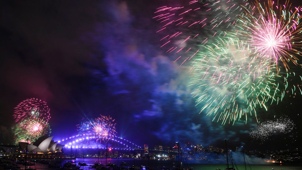 Fireworks explode over Sydney Harbour during New Year's Eve celebrations in Sydney, Sunday, Dec. 31, 2017. (David Moir/AAP Image via AP)