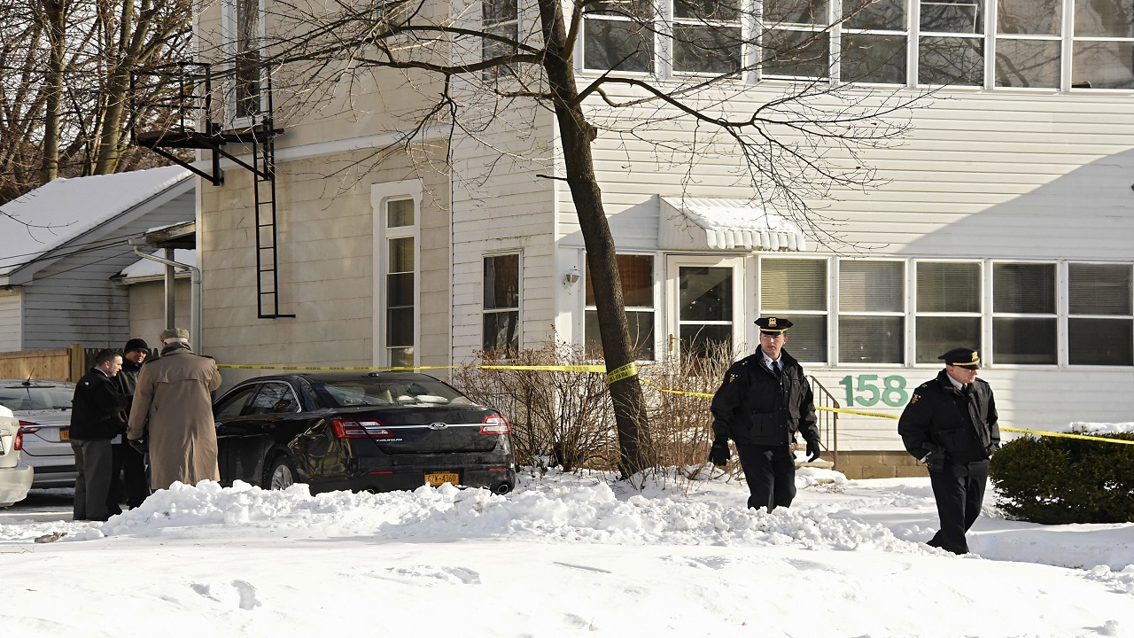 In a Tuesday, Dec. 26, 2017 file photo, Troy police investigate multiple deaths at 158 Second Ave., in Troy, N.Y. Officials announced early Saturday, Dec. 30 that two people have been arrested in the quadruple homicide that took the lives of two women and two children in their Troy, N.Y. apartment.