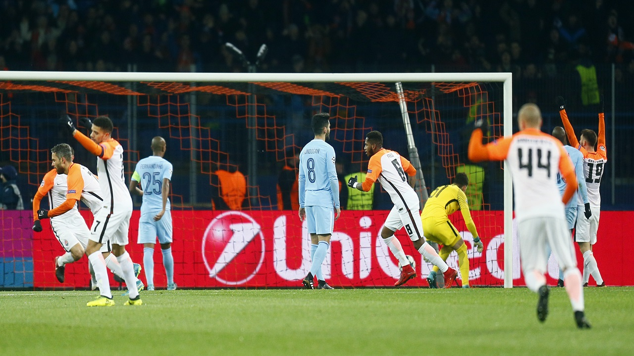 Shakhtar Donetsk players celebrate after scoring their side's opening goal during the Champions League group F football match against Manchester City  at the Metalist Stadium in Kharkiv, Ukraine, Wednesday, Dec. 6, 2017.
