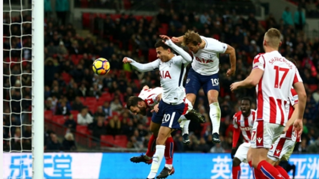 Tottenham's striker Harry Kane heads home against Stoke during their English Premier League football match on Saturday.