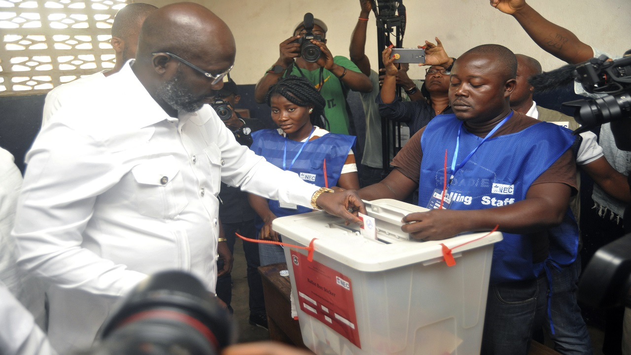Former football star George Weah, Presidential candidate for the Coalition for Democratic Change, casts his vote during a Presidential runoff election in Monrovia, Liberia on Tuesday.