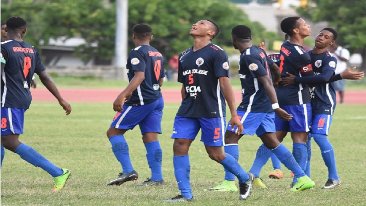 Jamaica College (JC) players celebrate a goal in a recent Manning Cup match. The school will put its Olivier Shield title, which it won for the last four seasons, on the line on Saturday. Will JC celebrate against Rusea's High?
