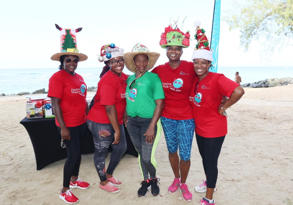 Elegant Hotels Group's team members pose with their festive hats made for the walk.