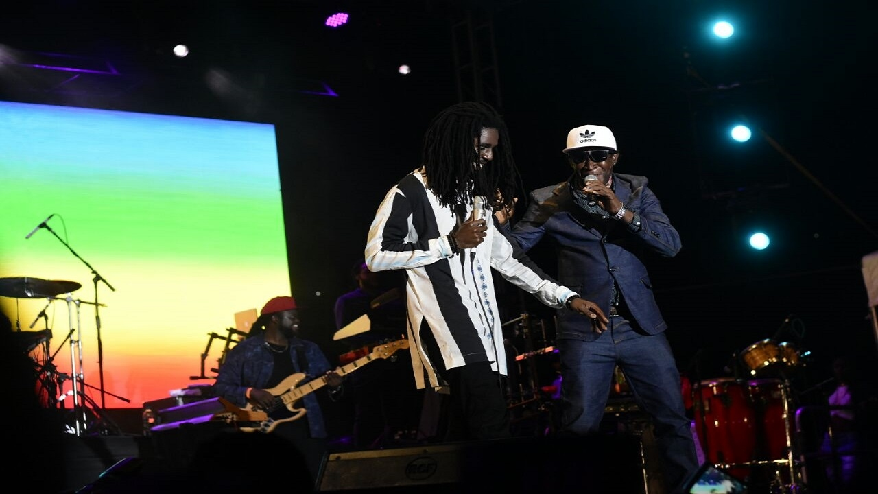 Chronixx and his father Chronicle on stage during the Chronology Tour concert stop in Kingston. (PHOTO: Marlon Reid)
