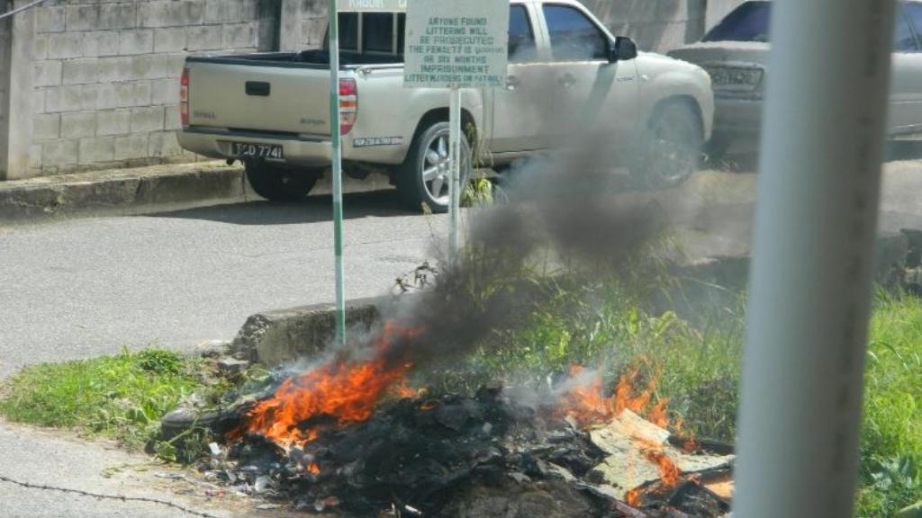 Citizen journalist captures burning rubbish at Dinsley Road, Tunapuna.