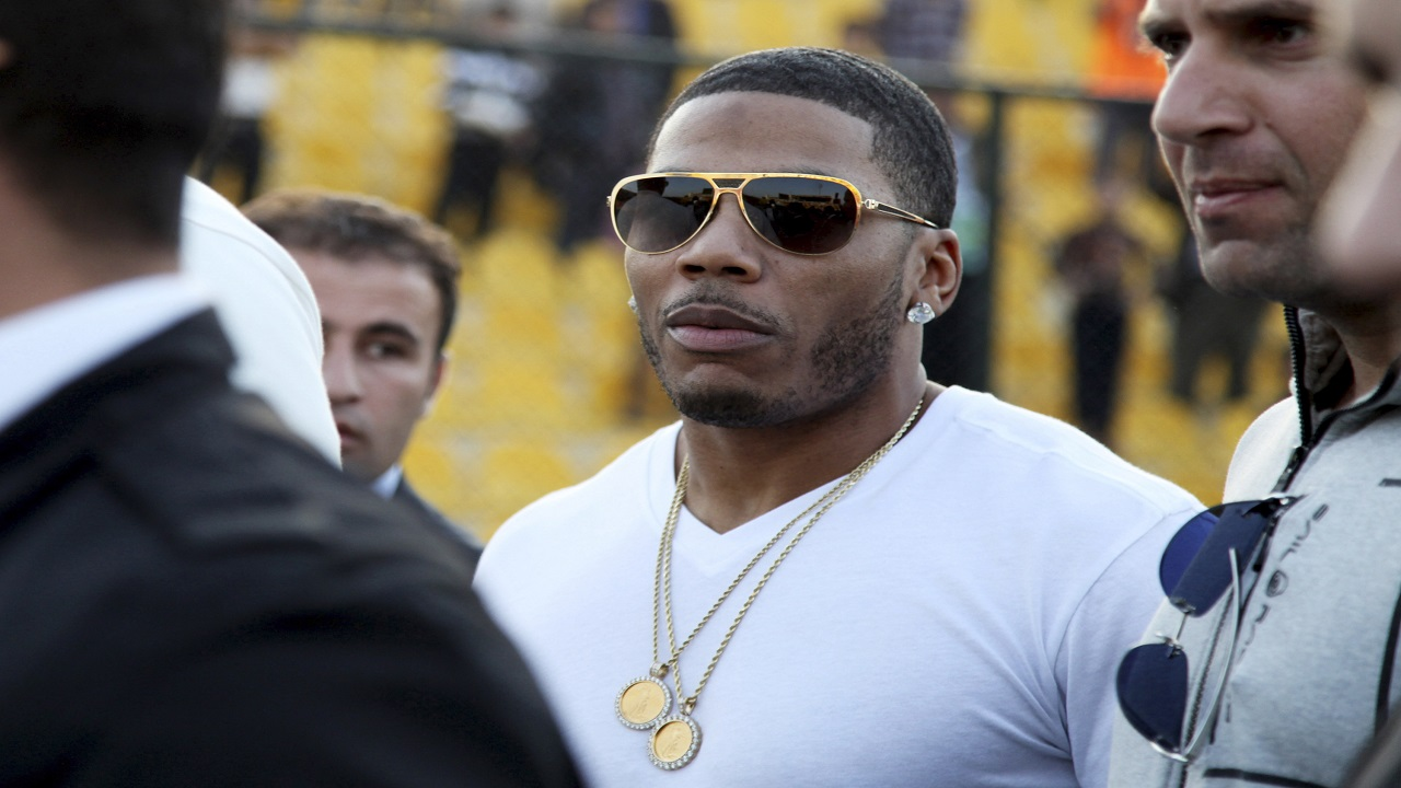FILE- In this March 13, 2015, file photo, rapper Nelly approaches the stage for a concert in Irbil, northern Iraq. (PHOTO: AP)