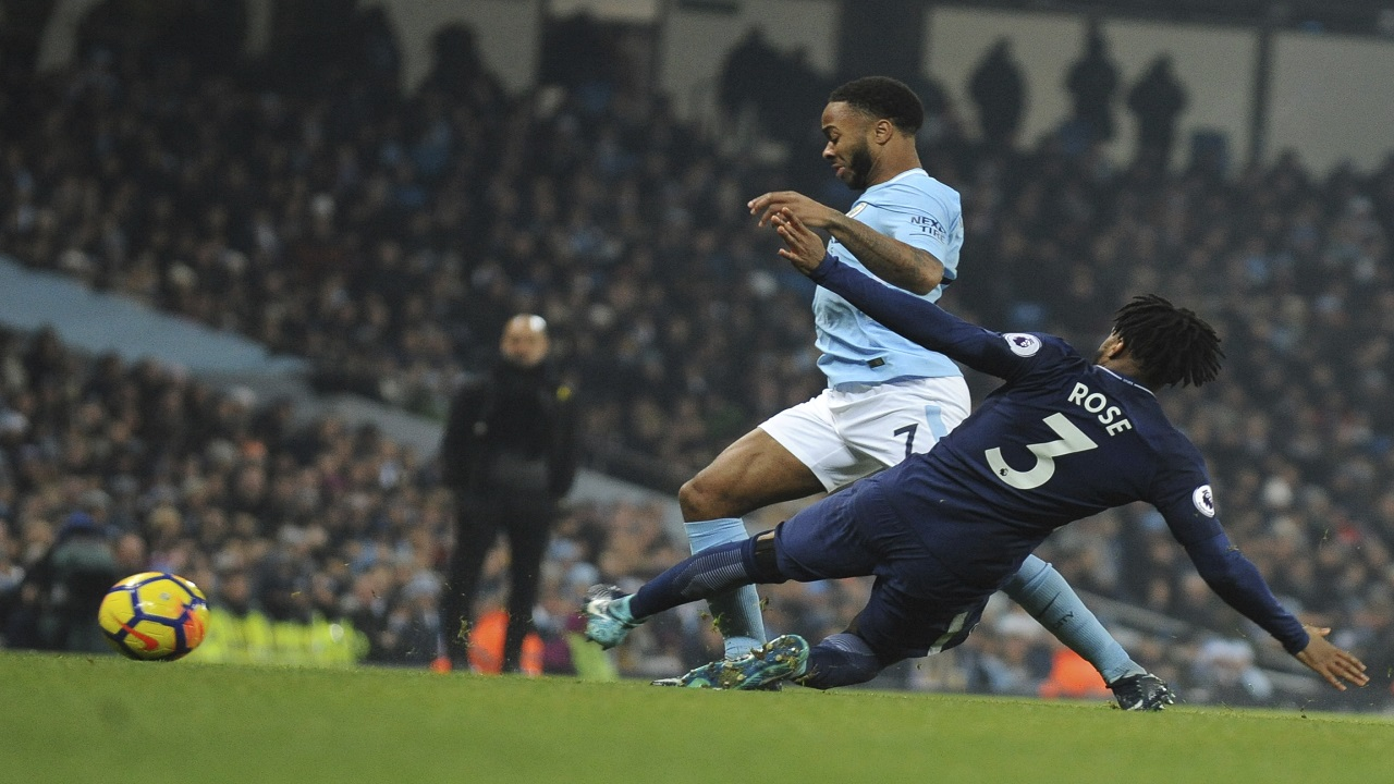 Manchester City's Raheem Sterling, left, and Tottenham's Danny Rose battle for the ball during their English Premier Leaguefootball match  at Etihad stadium, in Manchester, England, Saturday, Dec. 16, 2017.