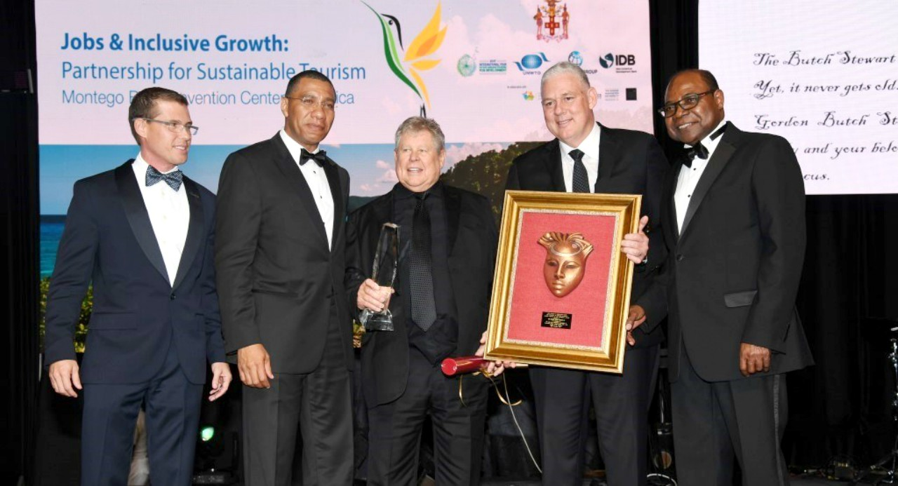 Hon. Gordon Butch Stewart (centre) with Adam Stewart CEO of Sandals Resorts International (left) and Prime Minister of Jamaica Hon. Andrew Holness (second from left), Prime Minister of St. Lucia Hon. Allan Chastanet (second from right) and Jamaica Minister of Tourism Hon. Edmund Bartlett (right).